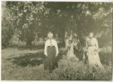 Sidna Robinson and her daughter under an apple tree