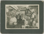 Sprague's Cannery, Lewiston-Clarkston Fruit Agency, interior view with workers and child,...