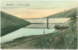 Clarkston reservoir with men and boys standing at edge, Clarkston, Washington, 1908