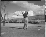Man golfing at Clarkston Country Club, Clarkston, Washington, March 25, 1951