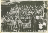 Clear Lake Lumber Company employees, group portrait, including sign with company logo, circa...
