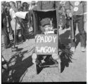 Child in Connell Parade holding a 'Paddy Wagon' sign, Franklin County, Washington, 1960s