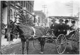 Unidentified couples in one-horse buggy, North Pearl Street, Ellensburg, Washington, circa...