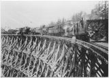 Trestle and rotary snowplow