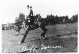 Buff Iverson, saddle bronc riding at the Ellensburg Rodeo, 1927