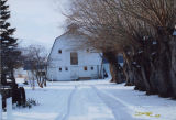 Tall white barn in snow