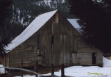 Weathered barn in winter