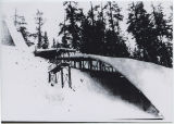 Ski jump and ski run covered in snow