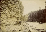 On horseback on a rocky trail, Kittitas County, Washington, circa 1900-1909