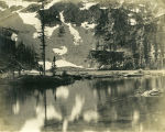 Spots of snow reflected in the water of unidentified lake, central Washington State circa 1900-1909