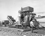 Ellensburg Air Base, men working with Rex concrete mixer, July 22, 1943