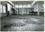Floor before pour, steam heat pipes, machine shop