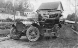 Axel Stridell in new car, on a road in Kalama, Washington circa 1910