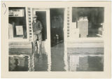 Laurence Ruth standing in doorway during flood, Kalama, Washington, 1948