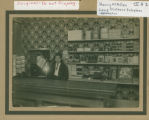 Harry McMillan inside telephone exchange store