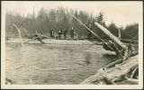 Nessets with friend on temporary bridge over South Fork Nooksack River, circa 1915