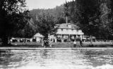 Hotel Crescent with cars and people, Piedmont, Lake Crescent