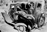 Automobile in yard after wreck, Olympic Peninsula, Washington
