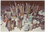 Paintbrushes and jars of pigment, Louis Mideke studio, Bellingham, Washington, circa 1960