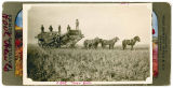 Farm workers on machinery, Lincoln County, Washington