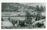 Kettle Falls with tipis and wagons