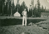 Man standing near medic flag, Mount Misery, Washington, 1933