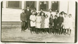 Rosenoff School students standing outside the school