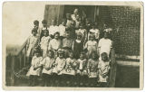 Class portrait on steps, postcard, Rockford, Washington, ca. 1900-1909