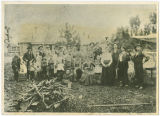 Group portrait near railroad depot, Rockford Washington, 1902