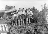 Fourth of July parade, girls on log float, Roslyn, Washington, circa 1930-1945