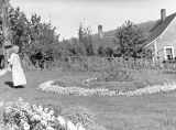 Theresa Panieri in garden, summer of 1938