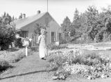 Theresa Panieri in garden, summer 1938