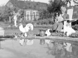 Theresa Panieri, seated next to garden pool, summer of 1939
