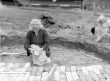 Theresa Panieri, working on brick pathway, April 1938