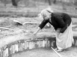Theresa Panieri with trowel, April 1938