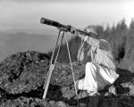 Alton Johnson, West of Goat Peak with telescope, October 10, 1937