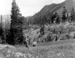 J Kane and Father Paul in a flower meadow near Ingalls Lake, August 16, 1935