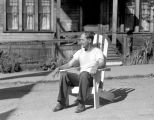 Rainie Griffin sittling in lawn chair, July 1, 1949