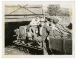Frank Badda with men on coal cart at No. 9