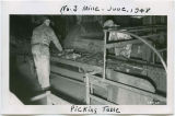 Miners sort coal at No. 3 Mine picking table