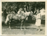 Pat Woodell on horseback with her mother