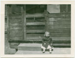 Kathleen Kladnik sits on front porch at Grandma and Grandpa Dalle's farm