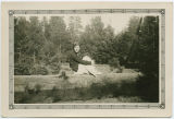 Olga Bannister sitting on log