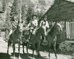 Pat Woodell and her parents on horseback