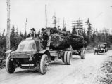 Old log truck with car behind