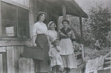 Jennie Marshall with others outside a house
