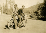 Bill Hinderman and Paul Cummings on a motorcycle at Twin Buttes