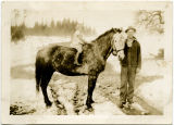 Barbara Neece sitting on General (the horse) with her uncle Clarence Skaar