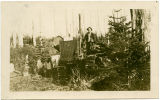 Unidentified man sitting on a Caterpillar tractor