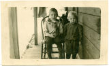 George and Clarence Skaar on the porch of the old Kinikberg house